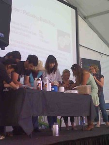 making a bath bag on stage at greenfest